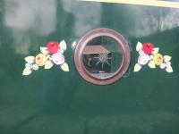 Traditional style vinyl canal roses either side of porthole