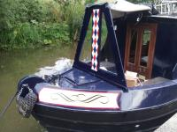 Beautiful Narrowboat with Traditional Style Vinyl Lettering for Narrowboats scroll on bows