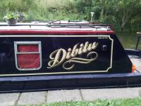 Beautiful Narrowboat with Traditional Style Vinyl Lettering for Narrowboats scroll beneath the name