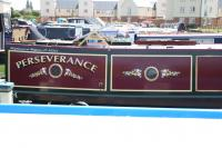 Traditional Style Vinyl Lettering for Narrowboats Traditional Style vinyl roses either side of porthole