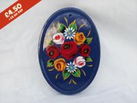 Oval Pottery Wall Plaque, blue background,  hand-painted with traditional canal rose design.