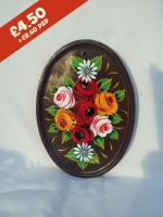 Oval Pottery Wall Plaque, brown background,  hand-painted with traditional canal rose design.